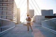 Exploring the city at sunset Stock Photos