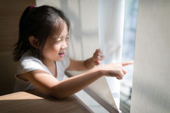 Exploring Concept Illustrated by Asian Child Looking and Pointin Royalty Free Stock Photography