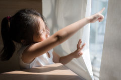 Exploring Concept Illustrated by Asian Child Looking and Pointin Royalty Free Stock Photos