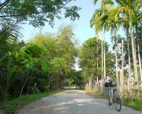 Exploring the countryside on bike in Asia stock photography