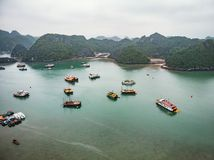 Exploring the islands and grottoes of Halong Bay is best done using one of the traditional junks that ply the narrow channels. Ha Long, Vietnam. A scenic view on stock image