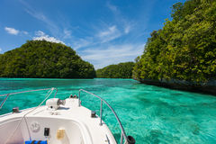 Exploring limestone islands in Palau. Exploring scenic lagoon of Palau is characterized by hundreds of limestone islands Stock Photo