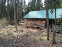 Exploring a log cabin during a kamloops wilderness hike Stock Photo