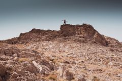 Exploring - lonely human walking in a rocky desert freedom and adventure lifestyle and sport concepts. Exploring - lonely human walking in a rocky desert royalty free stock photography