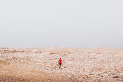 Exploring - lonely human walking in a rocky desert freedom and adventure lifestyle and sport concepts. Exploring - lonely human walking in a rocky desert royalty free stock photos
