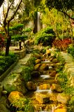 Calm waterfall from top of the hill down to the garden alley for romantic adventure in the morning sunrise stock image