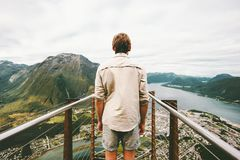Exploring Norway Man traveler enjoying aerial mountains landscape. Travel healthy Lifestyle adventure vacations standing alone on Rampestreken viewpoint stock images