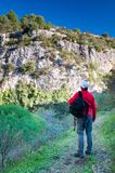 Exploring Pantalica. Hiker walking along the trails of the Anapo valley, by the rocky necropolis of Pantalica stock images