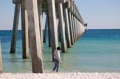 Exploring the Pensacola Fishing Pier. A young woman idly explores the fishing pier on Pensacola beach, Florida Stock Photography