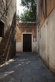 Exploring Venice through small streets and alleys in the summertime. Stock Photo