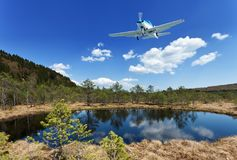 Exploring the wilderness - small aircraft flying above scenic vi Stock Photos