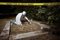 Explorint place of crime. Crime scene investigation - collecting of evidence on place of crime Royalty Free Stock Photos