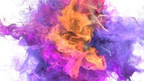 Explosão de cor - resíduo metálico alfa das partículas fluidas amarelas roxas coloridas da explosão do fumo