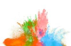 Explosão de poeira colorida no fundo preto imagens de stock royalty free