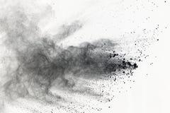 Explosão do pó preto no fundo branco Nuvem colorida A poeira colorida explode Pinte Holi fotografia de stock royalty free