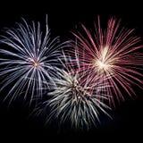 Explosões dos fogos-de-artifício no céu preto Fotos de Stock Royalty Free