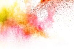 Explosión de polvo multicolora abstracta en el fondo blanco Foto de archivo libre de regalías