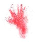 Explosión de polvo roja aislada en el fondo blanco Imagenes de archivo