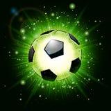 Explosión del balón de fútbol Fotos de archivo