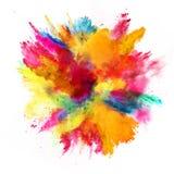 Explosión del polvo coloreado en el fondo blanco Imagenes de archivo