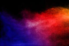 Explosión del polvo del multicolor en fondo negro Foto de archivo libre de regalías