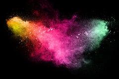 Explosión del polvo del multicolor en fondo negro Imagen de archivo libre de regalías