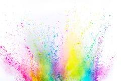 Explosi?n coloreada del polvo en el fondo blanco imagenes de archivo