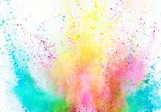 Explosi?n coloreada del polvo en el fondo blanco foto de archivo