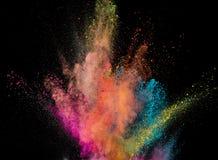 Explosi?n coloreada del polvo en fondo negro imagen de archivo libre de regalías
