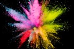Explosi?n coloreada del polvo en fondo negro foto de archivo libre de regalías