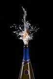 Explosie van cork van de champagnefles stock afbeeldingen