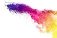 Explosie van gekleurd die poeder, op witte achtergrond wordt geïsoleerd De samenvatting van gekleurd stof splatted kleurenwolk royalty-vrije stock foto's