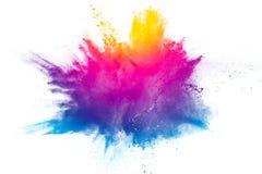 Explosie van het poeder van de regenboogkleur op witte achtergrond royalty-vrije stock afbeelding