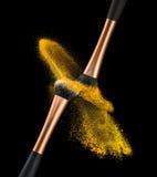Explosión del polvo del cepillo del maquillaje Fotografía de archivo