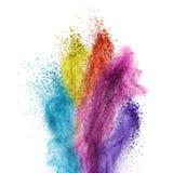 Explosión del polvo del color aislada en blanco Imagen de archivo