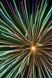 Explosion. Single white firework explosion with blue streamers Stock Photography