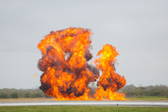Explosion at airport. Big explosion with fire and smoke at industrial facility stock photo