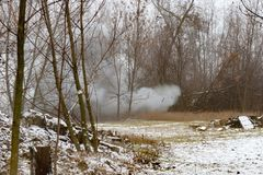 The explosion of anti-tank mines at the site, the smoke in the woods royalty free stock images