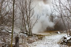The explosion of anti-tank mines at the site, the smoke in the woods stock photo