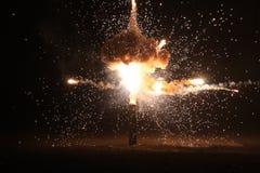 Explosion auf dem schwarzen Hintergrund Stockfotografie