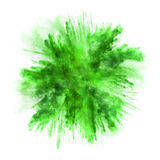 Explosion av grönt pulver på vit bakgrund Royaltyfri Foto