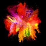 Explosion av kulört pulver på svart bakgrund Royaltyfri Fotografi