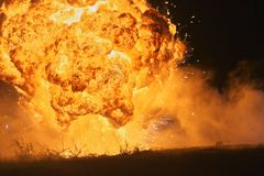 Explosion with big fireball 01. Explosion with big fireball on the ground in the night. Please check similar images in my portofolio Royalty Free Stock Photography
