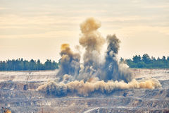 Explosion blast in open cast mining quarry mine Royalty Free Stock Images