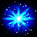 An explosion on a blue background Royalty Free Stock Photo