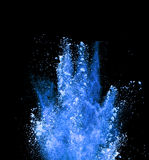 Explosion of blue powder on black background Royalty Free Stock Photography