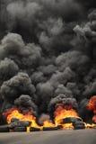 Explosion and burning wheels causing huge dark smo Stock Photos