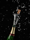 Explosion of champagne bottle Royalty Free Stock Photos