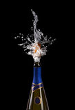Explosion of champagne bottle cork. Champagne bottle with shooting cork on black background Stock Images