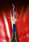 Explosion of champagne bottle cork. Champagne bottle with shooting cork on RED background Stock Photo